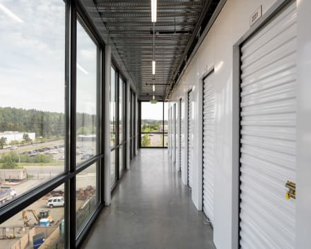 Storage units with windows in the hallway at StorQuest Self Storage in Redmond, Washington