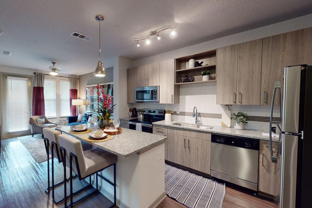 Kitchen with granite countertops at Integra 289 Exchange in DeBary, Florida
