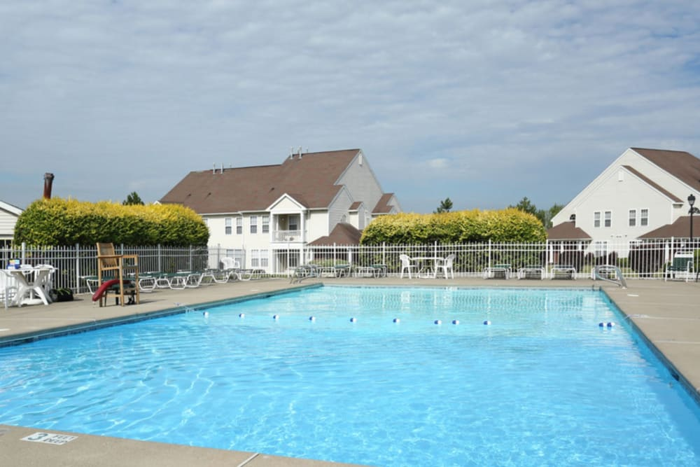 Poolside with seating at Bennington Hills Apartments in West Henrietta, New York