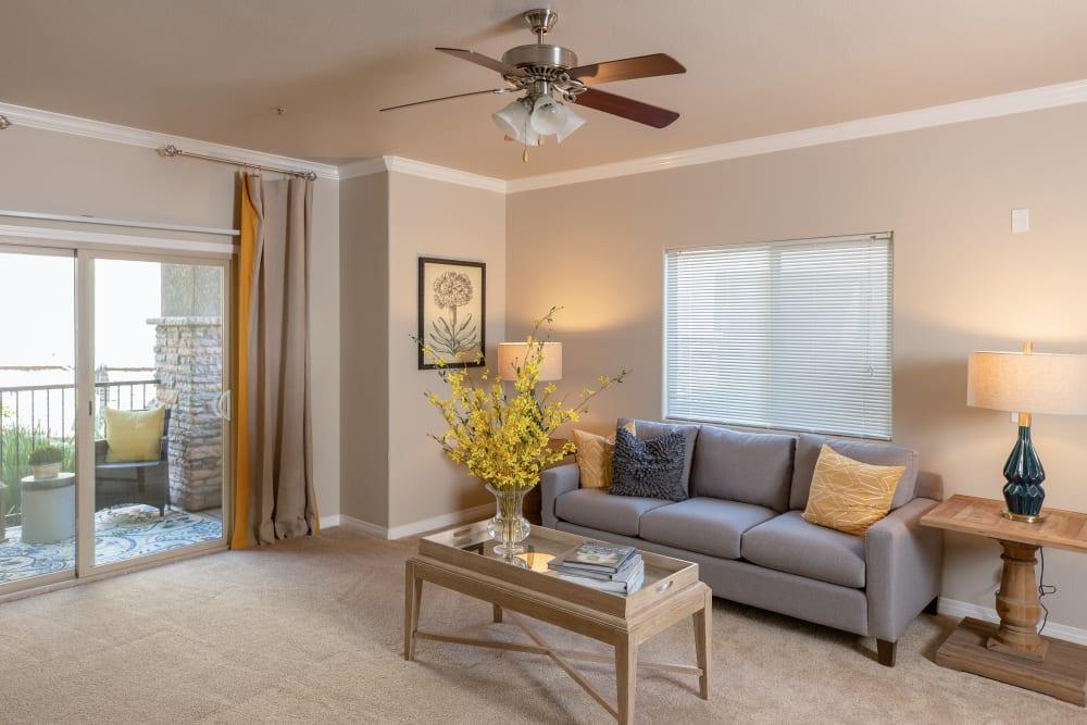 Spacious and cozy living room with patio at Wolf Ranch Condominium Rentals in Sacramento, California