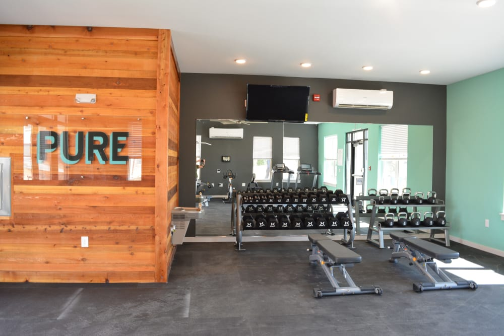 A fitness center with a weight rack at Pure St. Peters in Saint Peters, Missouri