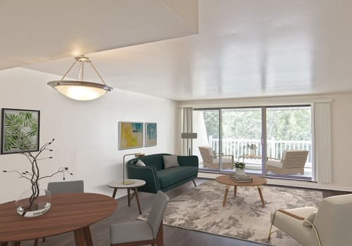 Living room with patio access at The Cascades Townhomes and Apartments in Pittsburgh, Pennsylvania