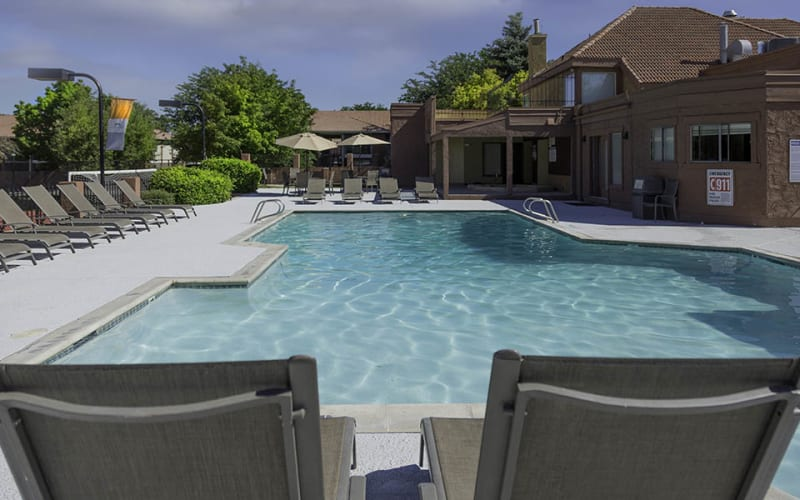 Relax by the pool at Shadowbrook Apartments in West Valley City, Utah