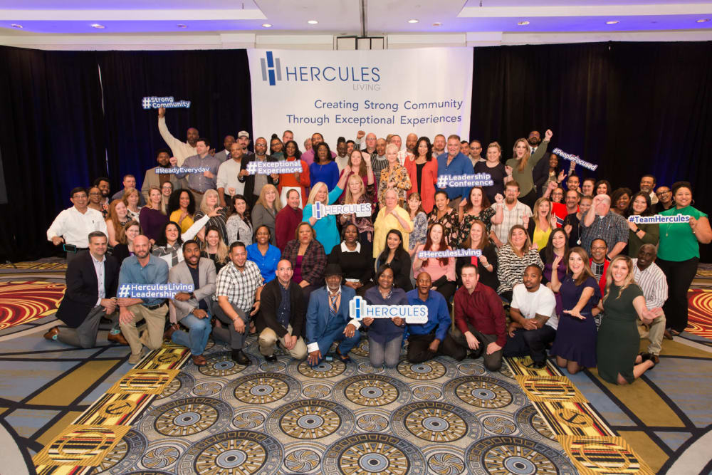 Employees from Hercules Living posing together at a company conference in Virginia Beach, Virginia.