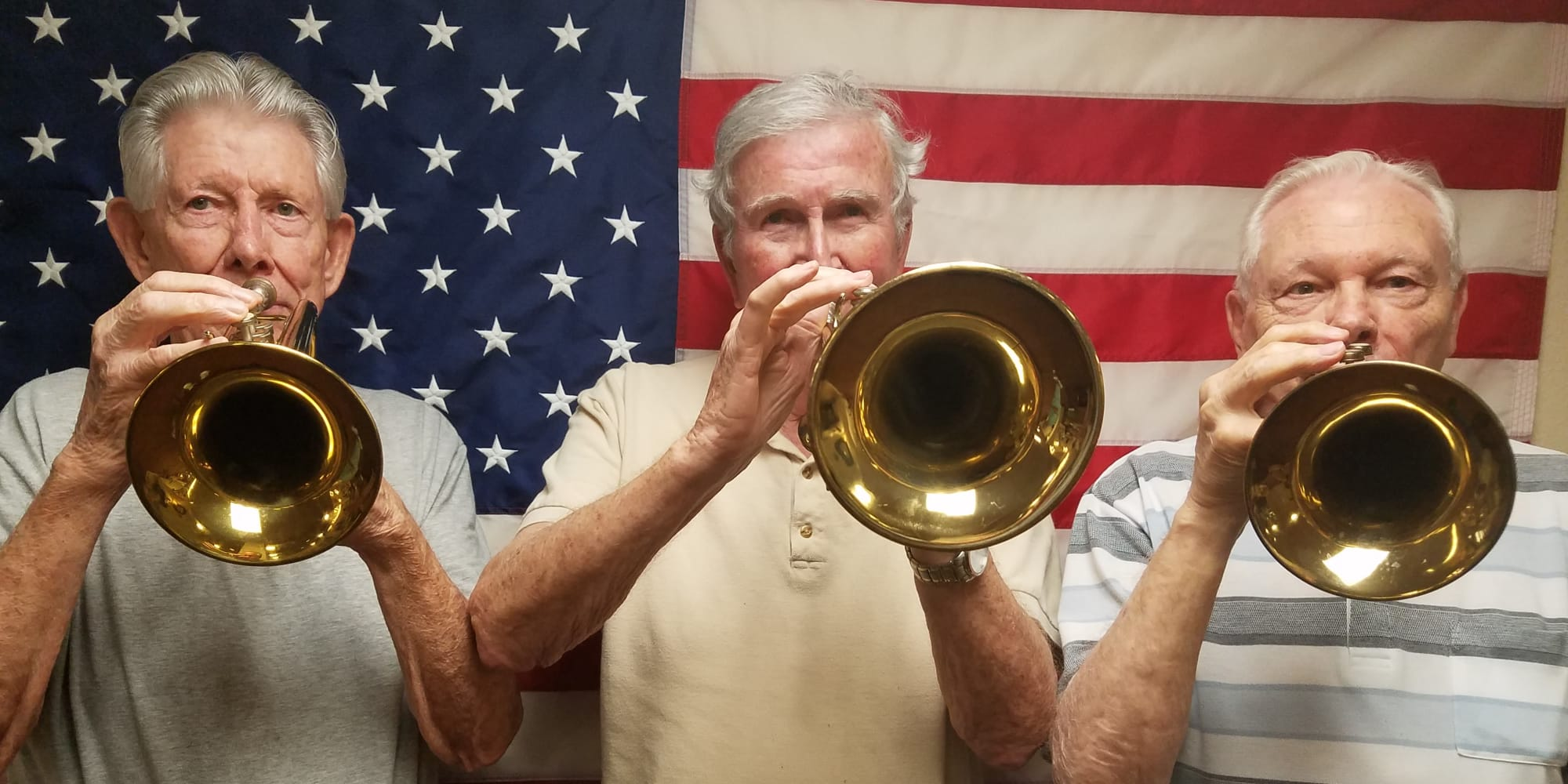 Residents playing trumpets at Mulberry Gardens Assisted Living in Munroe Falls, Ohio