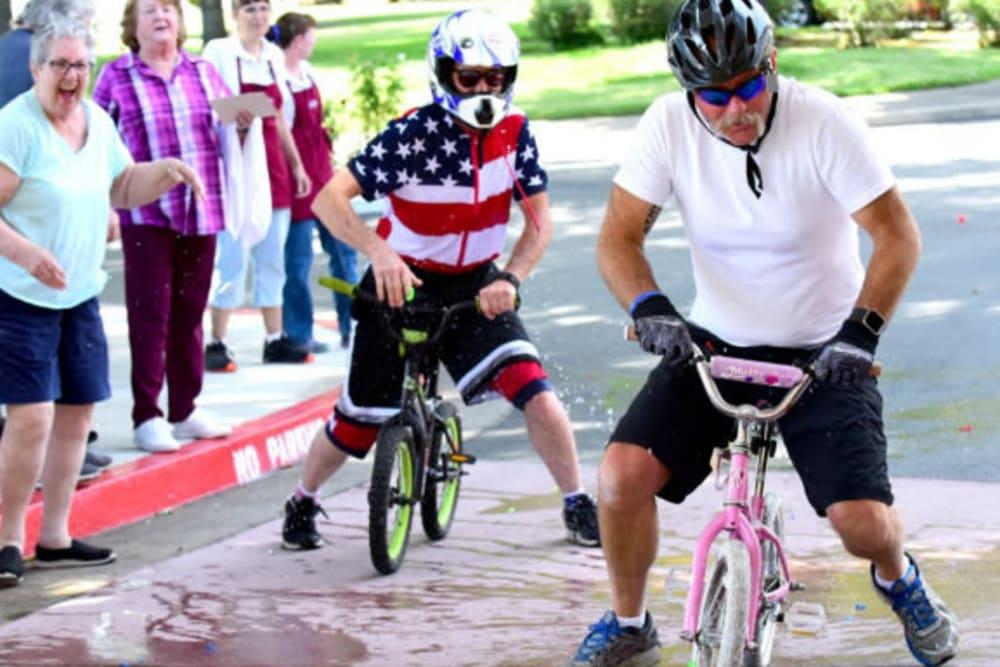 Resident enjoying a fun bike event at River Commons Senior Living in Redding, California