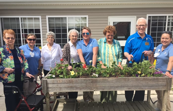 Residents and caretakers gardening at Tiffin in Tiffin, Ohio.