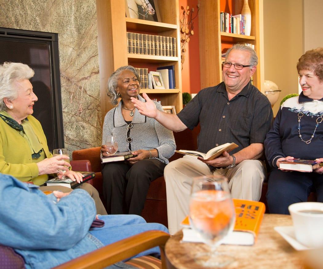 Residents enjoy a book club discussion at All Seasons Ann Arbor in Ann Arbor, Michigan
