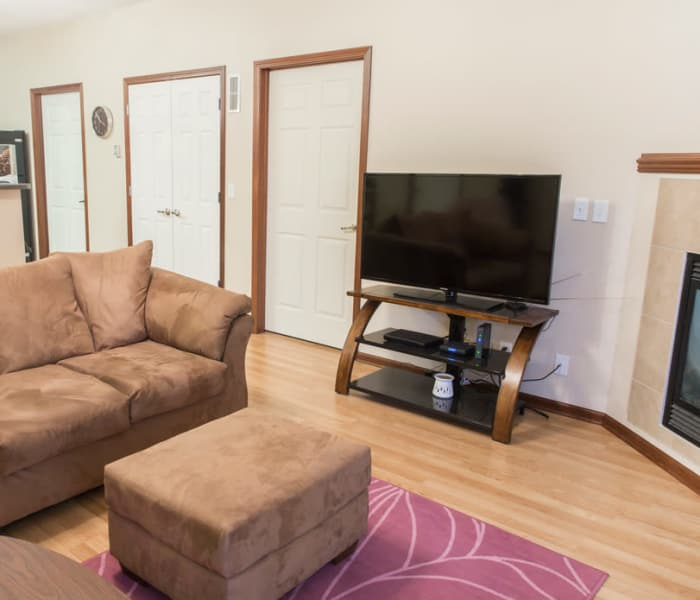 Comfortable living room with fireside seating at Golf View in Pleasant Hill, Iowa