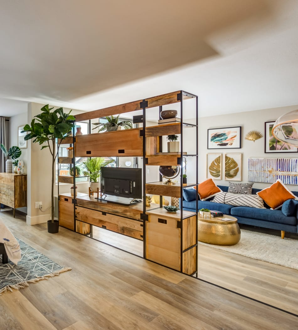 Open-concept living area with beautiful hardwood floors in a model home at Vue Los Feliz in Los Angeles, California