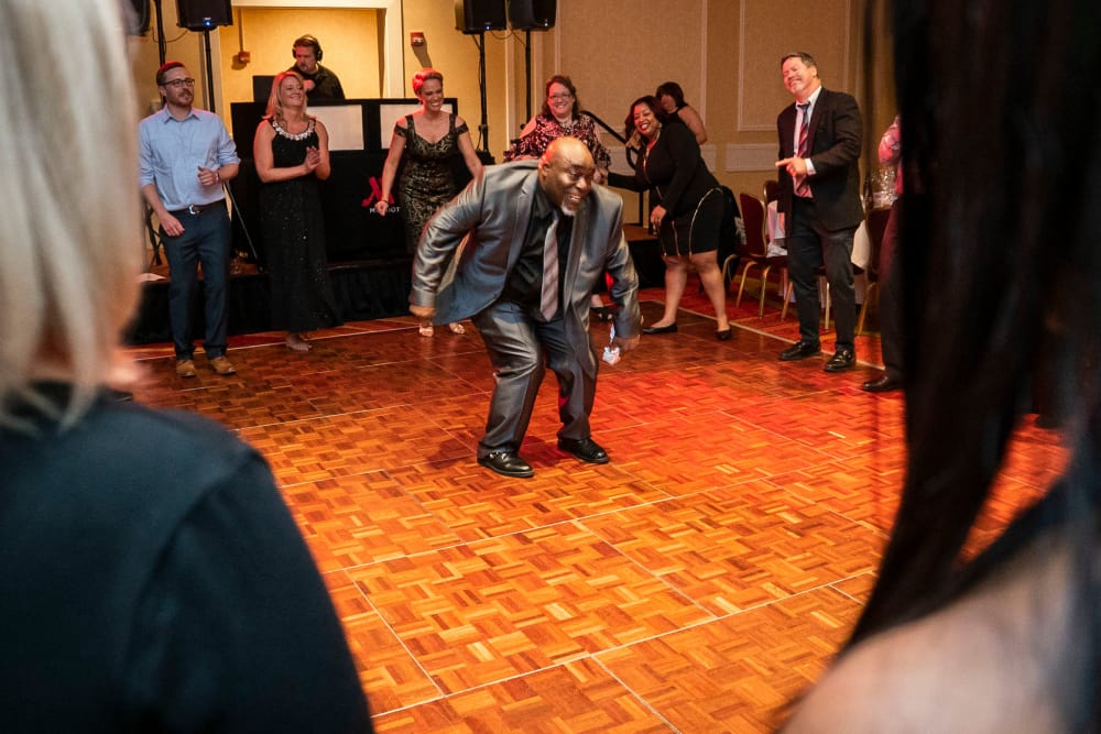 CAPREIT employee having fun dancing at a conference