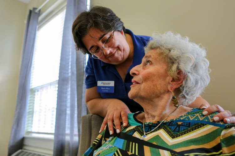 Resident getting help from staff at Harmony at Avon in Avon, Indiana