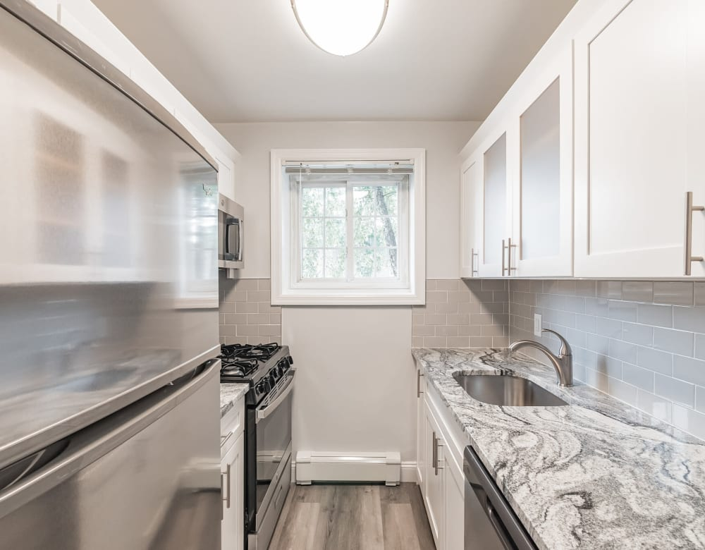 Bright kitchen at Eagle Rock Apartments at Carle Place in Carle Place, New York