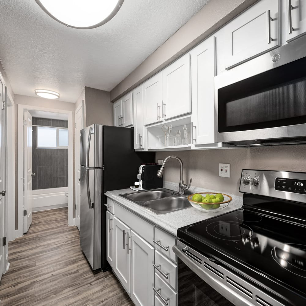 Stainless-steel appliances in model kitchen at Southglenn Place in Centennial, Colorado
