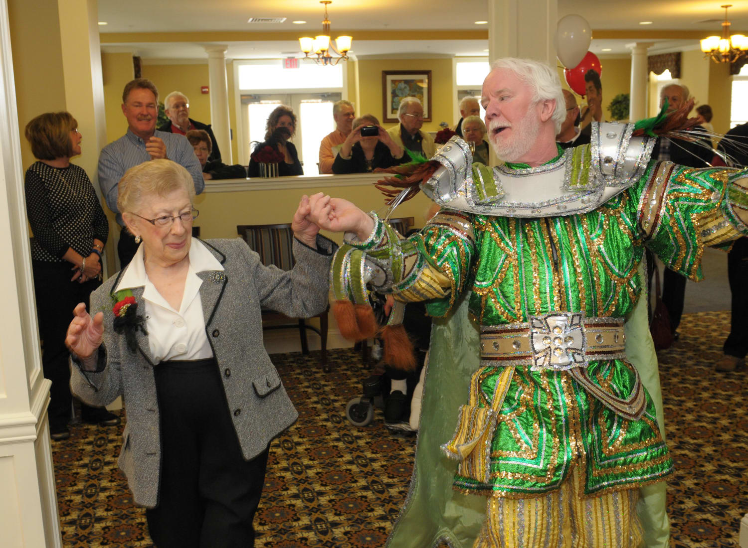 Resident dancing with someone dressed as a king at The Birches at Newtown in Newtown, Pennsylvania