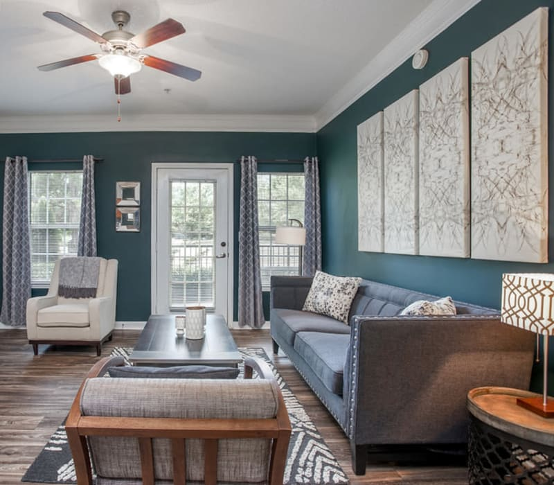 Living room with patio access at Meadow Springs in College Park, Georgia