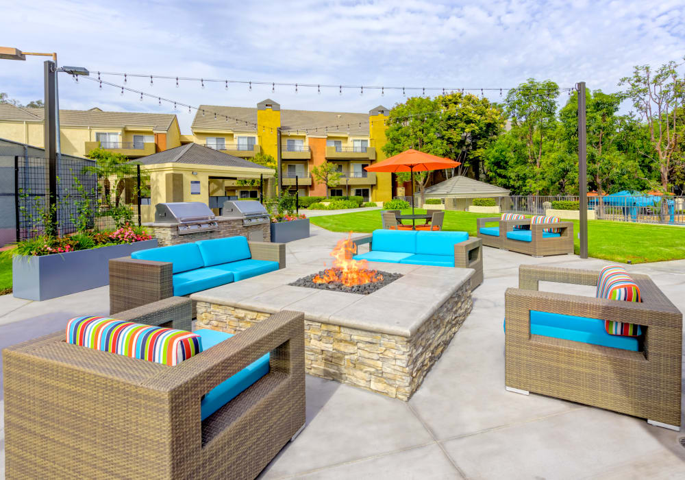 Well-designed outdoor lounge with a fire pit at Sofi Irvine in Irvine, California