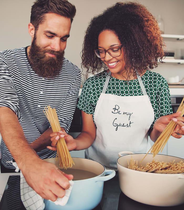 Couple cooking pasta together at Oaks Glen Lake in Minnetonka, Minnesota