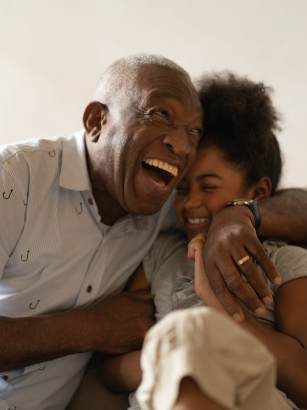 A resident and his granddaughter enjoying quality time in their home.