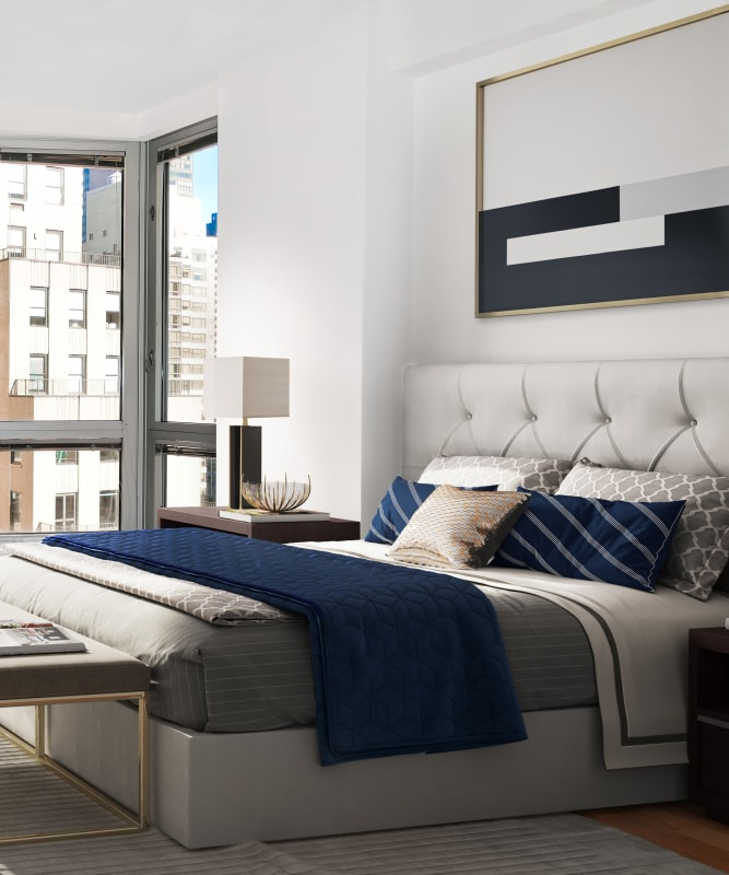 A bedroom with a windowed wall at The Metropolis in New York, New York