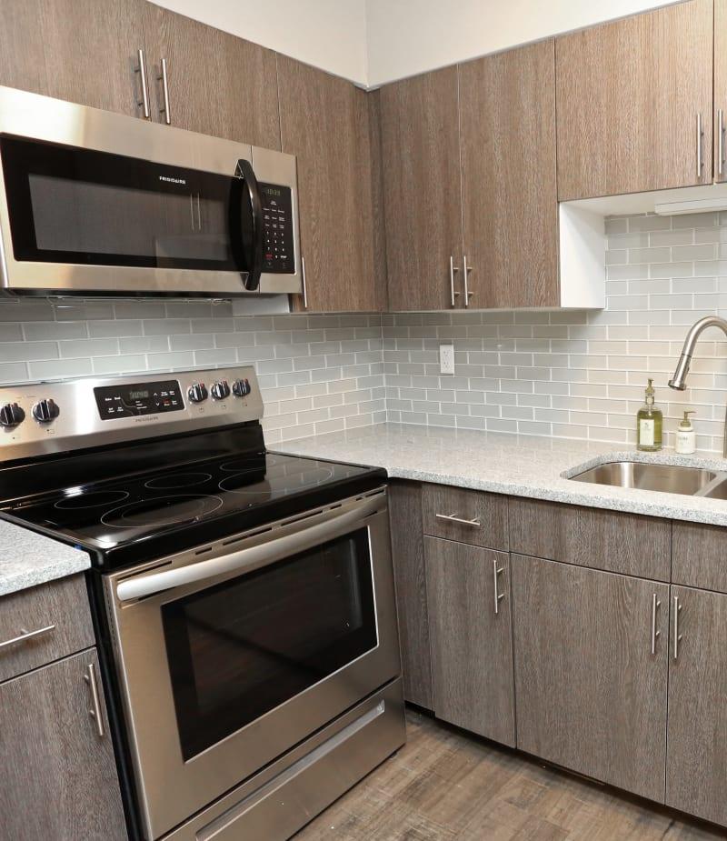 Sleek kitchen at The August Apartments in Lexington, Kentucky