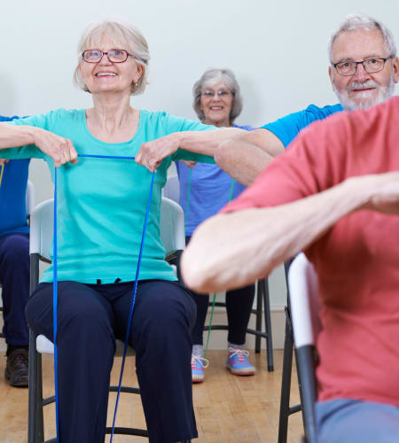Residents in a fitness class at Garden Place Columbia in Columbia, Illinois.