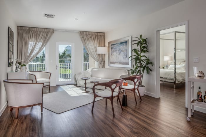 Beautiful living room with white accents at All Seasons Naples in Naples, Florida
