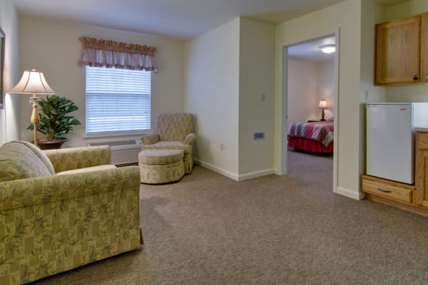 Assisted living apartment living room and kitchen at Southern Oaks in Henderson, Tennessee
