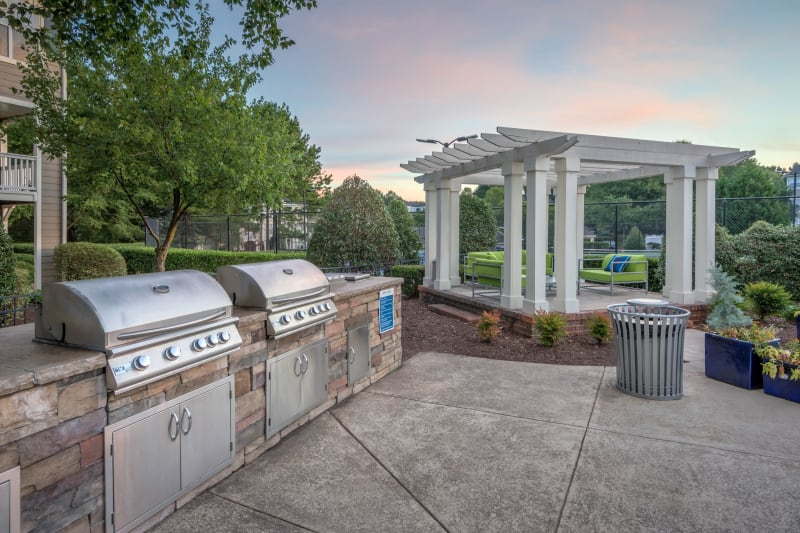 Barbecue area with gas grills overlooking the swimming pool at The Mark in Raleigh, North Carolina