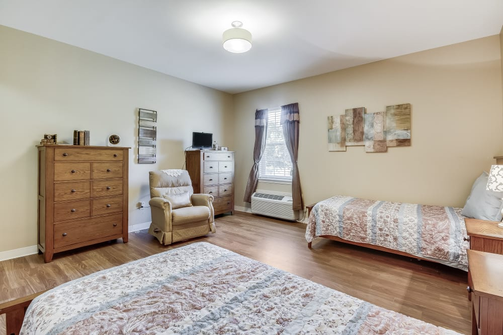 A shared bedroom with wood flooring at Magnolias of Chesterfield in Chester, Virginia