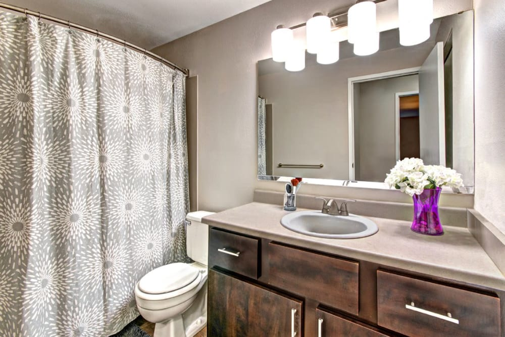 A bright and stylish bathroom at Wellington Apartment Homes in Silverdale, Washington