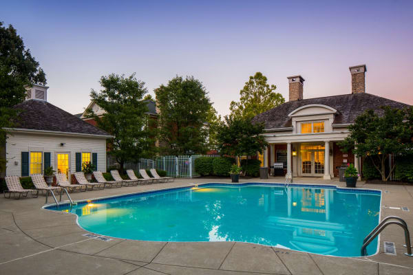 Pool with lots of lounge chairs at The Woods at Polaris Parkway Apartments & Townhomes in Westerville, Ohio