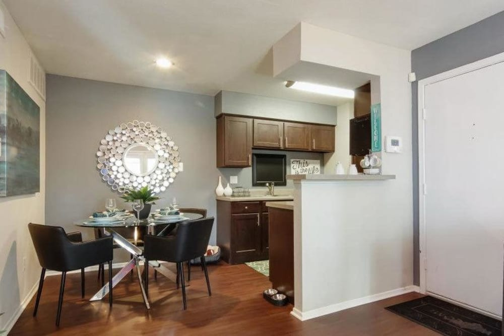 Open concept floor plan of kitchen and dining area with hardwood floors and modern decor at Vantage Point in Houston, Texas