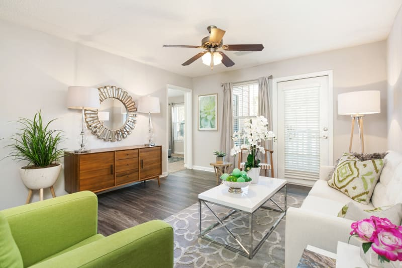 Spacious well-lit living room in a sleek, light modern home at Belle Vista Apartment Homes in Lithonia, Georgia