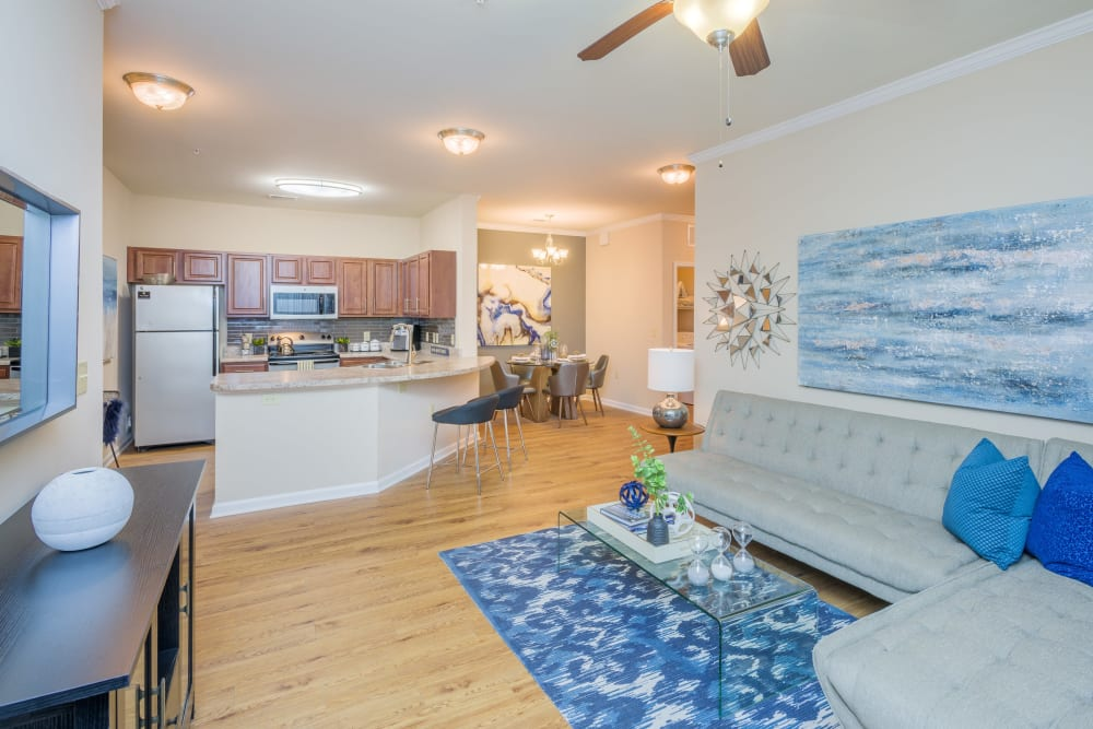 Open concept living room with wood floors at Arbor Village in Summerville, South Carolina