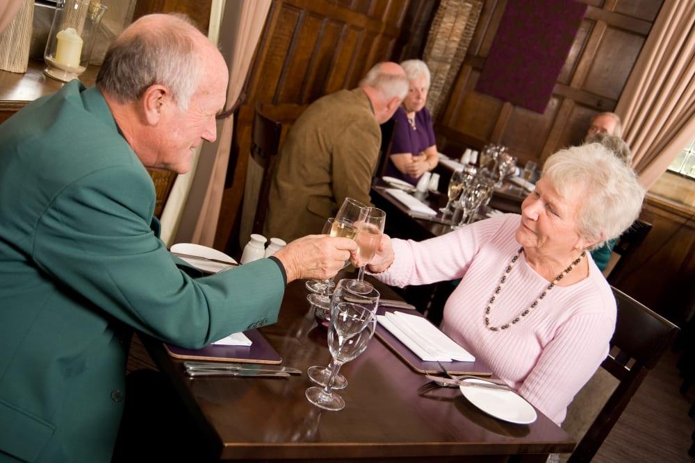 Residents having dinner at on-site restaurant at The Iris Senior Living in Great Falls, Montana