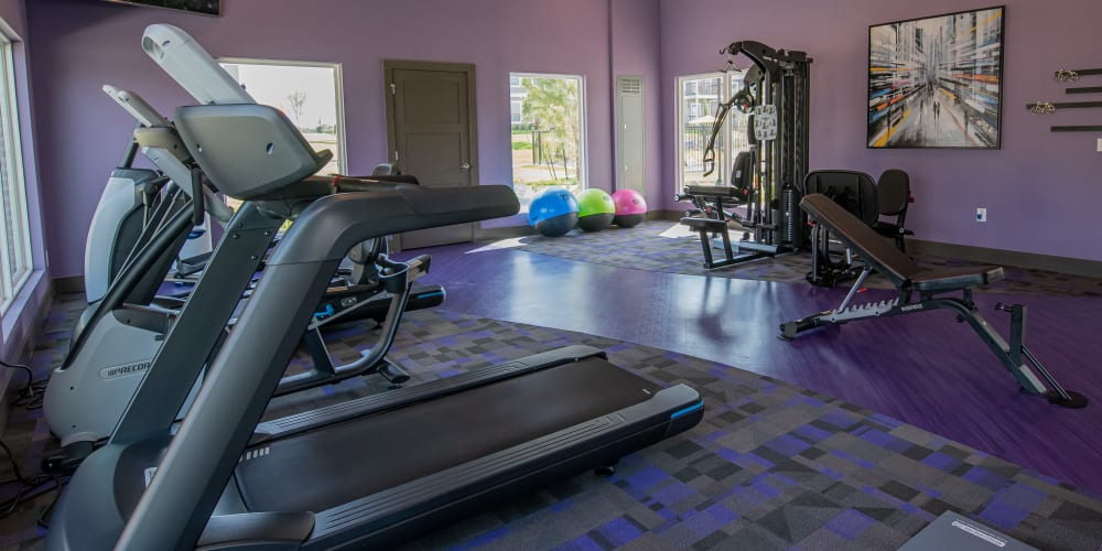 Well equipped fitness center at Cottages at Crestview in Wichita, Kansas