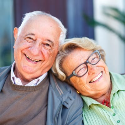 Resident couple sitting outside at Deer Crest Senior Living in Red Wing, Minnesota
