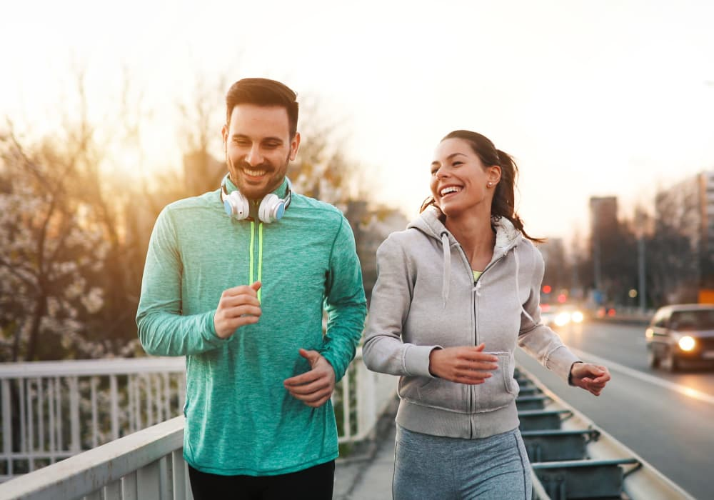 Couple jogging and running outdoors in nature near South Block Apartments in Salem, Oregon