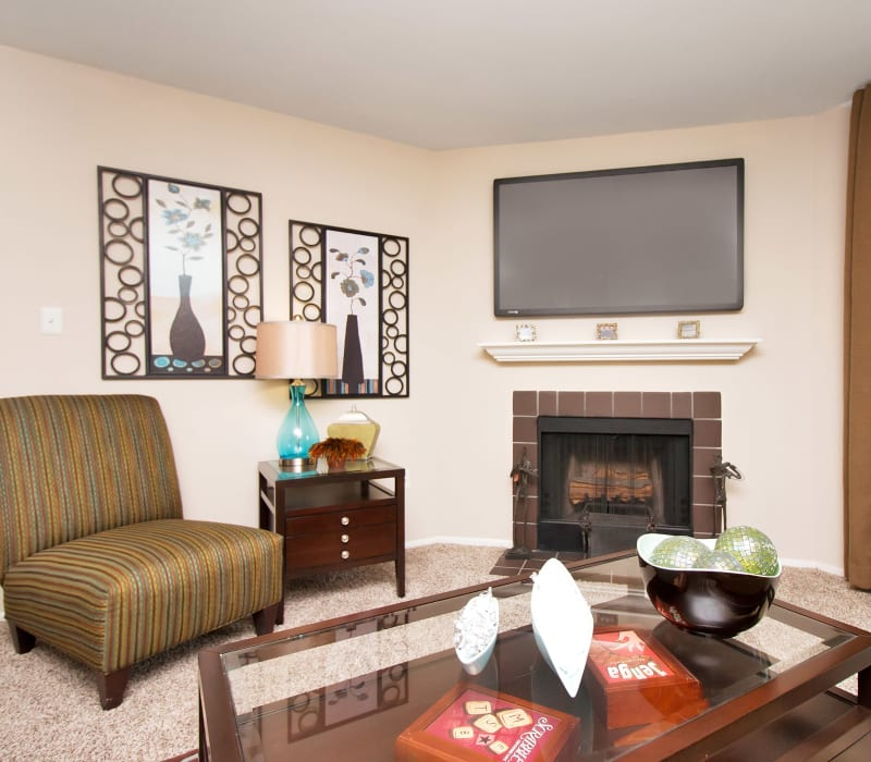 Living room with a fireplace at Runaway Bay Apartments in Virginia Beach, Virginia