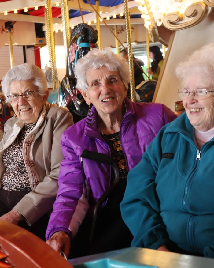 Residents connecting with other residents at a carousel at The Springs at Butte in Butte, Montana.