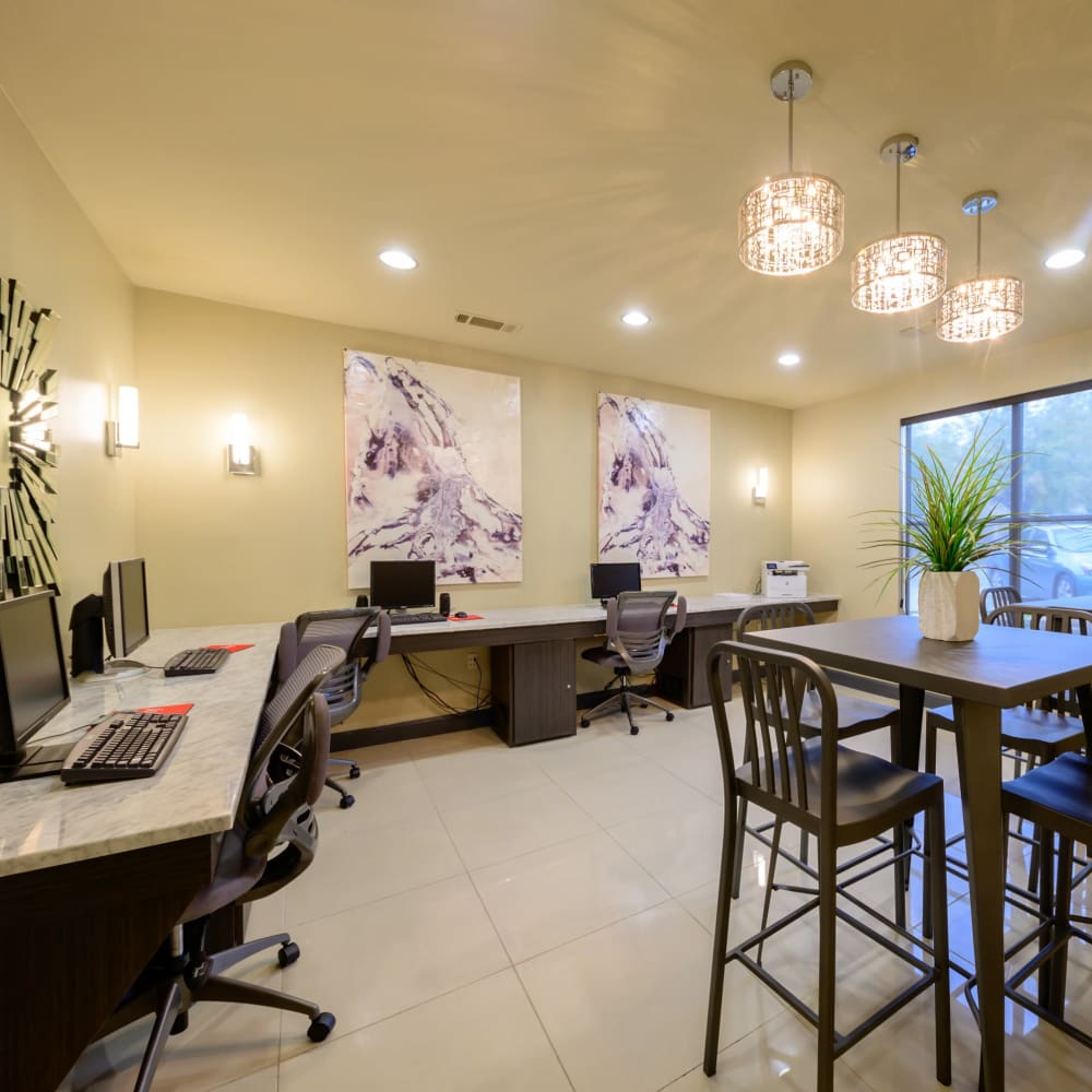 Community billiards room with tables and chairs at Artisan at Lake Wyndemere in The Woodlands, Texas