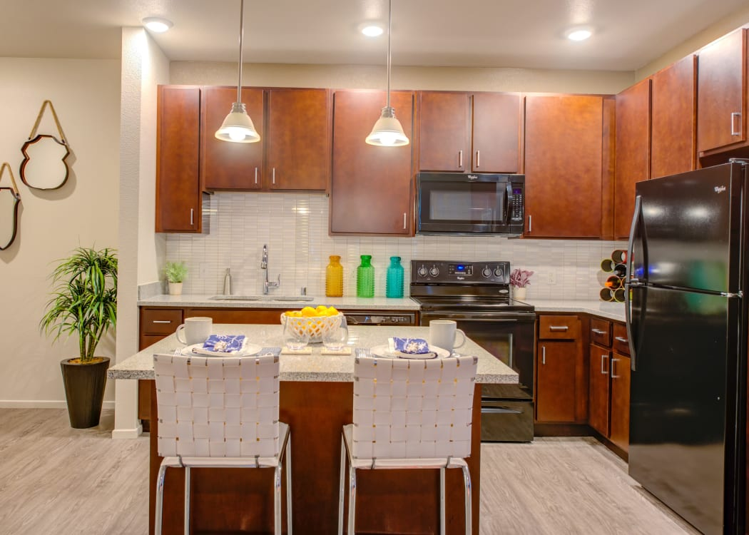Beautiful, open-concept floor plan with hardwood floors in model home at Kapolei Lofts in Kapolei, Hawaii