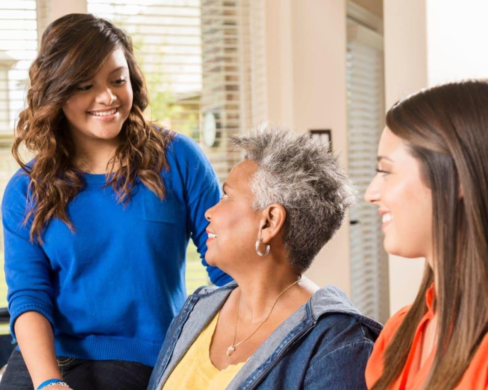 Family visits with resident at Milestone Senior Living in Faribault, Minnesota.
