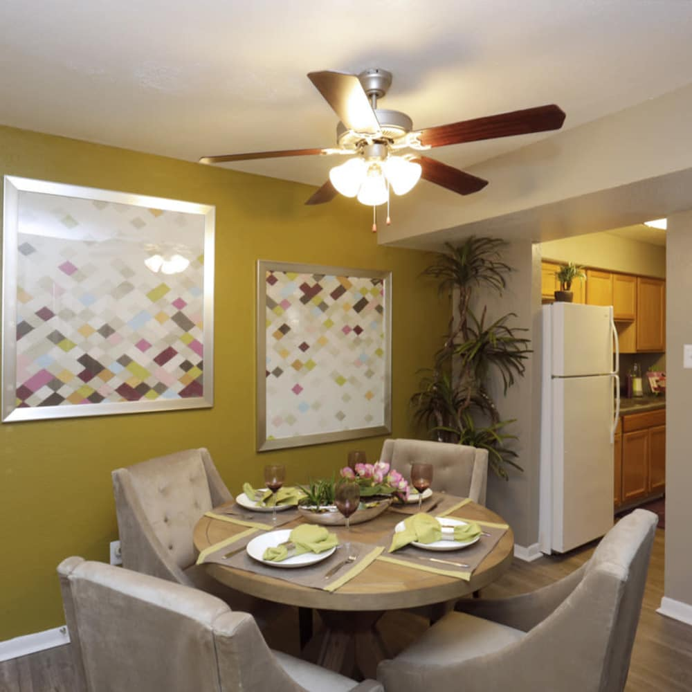 Beautiful dining room with ceiling fan at EnVue Apartments in Bryan, Texas