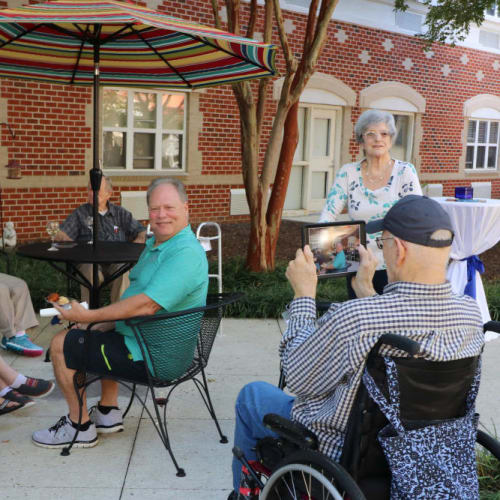 Residents enjoying time on the porch at The Crossings at Ironbridge in Chester, Virginia