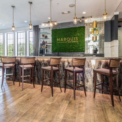 Indoor community room with counter seating and tall counter chairs at Marquis at Buckhead in Atlanta, Georgia
