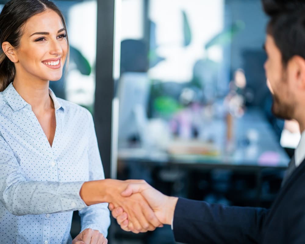 A job seeker shaking hands with the hiring manager at STOR-N-LOCK Self Storage
