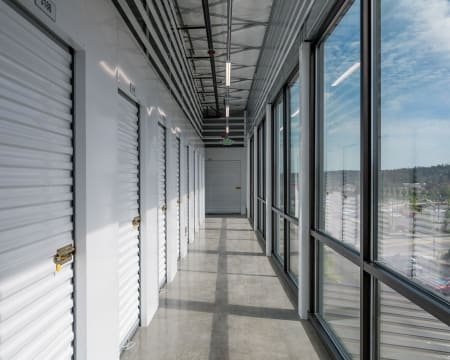Interior storage units along windows at StorQuest Self Storage in Redmond, Washington