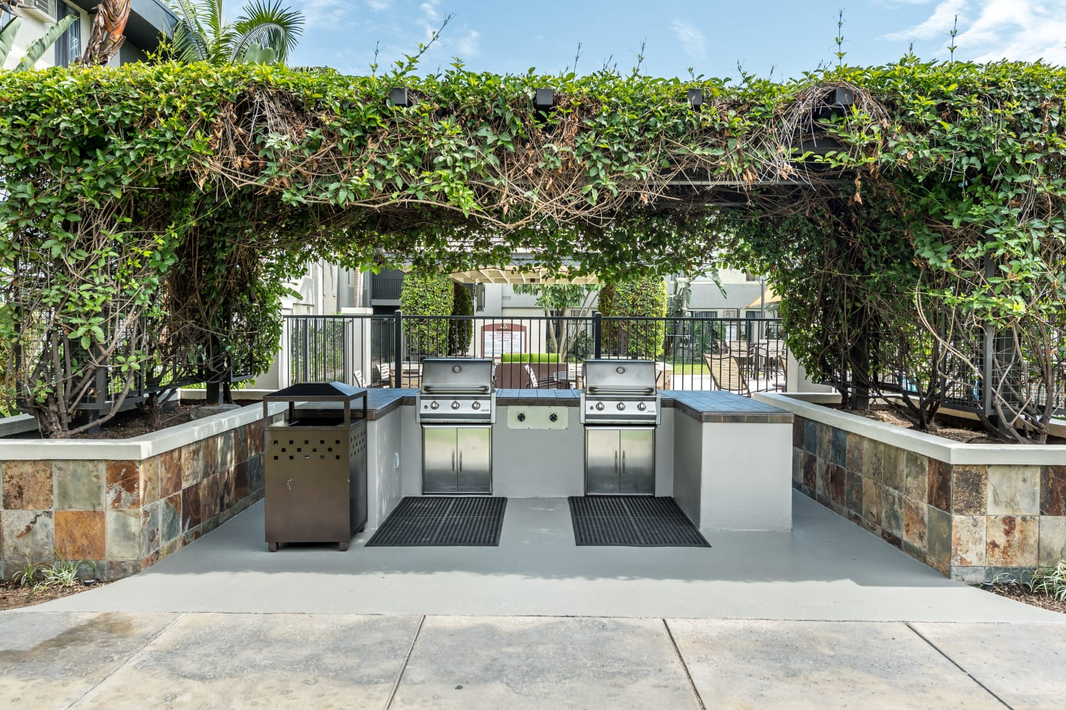 Enjoy a barbecue area at UCE Apartment Homes in Fullerton, California